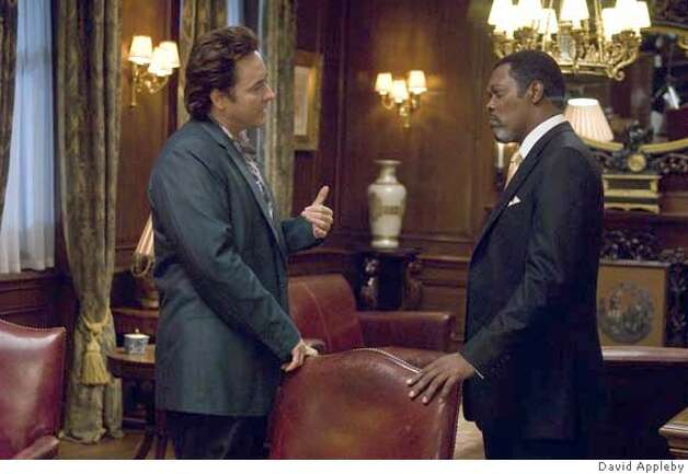 John Cusack (Mike Enslin) and Samuel L. Jackson (Mr. Olin) star in Mikael H�fstr�m's 1408. Photo: David Appleby