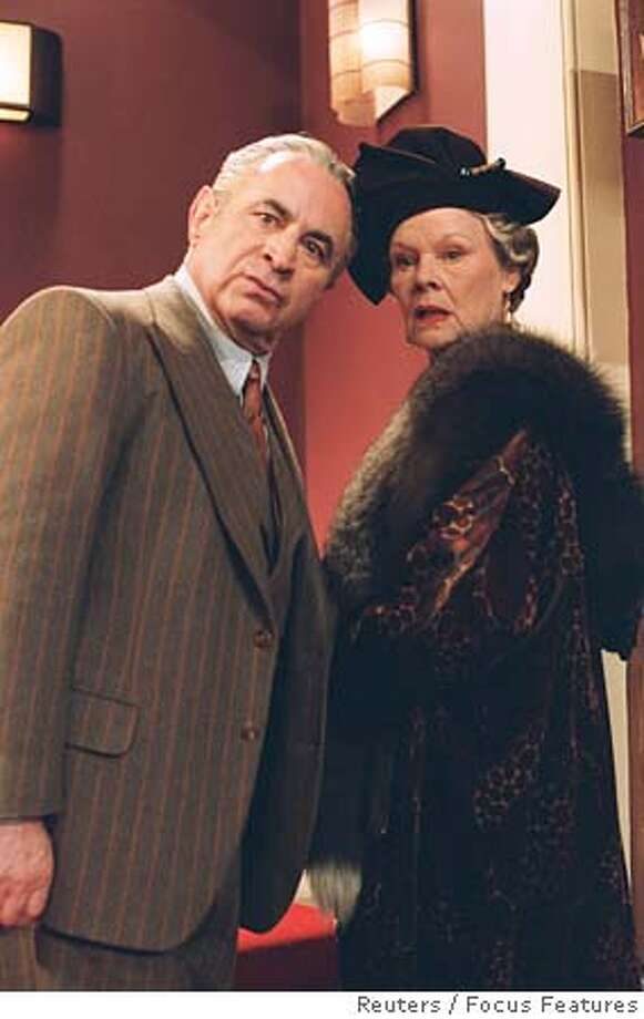Dame Judi Dench (R) and actor Bob Hoskins are shown in a scene from the film 'Mrs. Henderson Presents' in this undated publicity photograph. The film received three Golden Globe nominations, including best motion picture musical or comedy and best musical or comedy motion picture actress for Dench, as nominations were announced at a news conference in Beverly Hills December 13, 2005. The award show which honors excellence in film and television will be telecast to a worldwide audience from Beverly Hills January 16, 2006. NO ARCHIVES REUTERS/Focus Features/Handout Ran on: 12-25-2005  Kestie Morassi as Kristy stars in the fact-based horror film &quo;Wolf Creek,&quo; which is about three road-trippers who get stranded in rural Australia and accept help from a stranger. 0 Photo: Focus Features