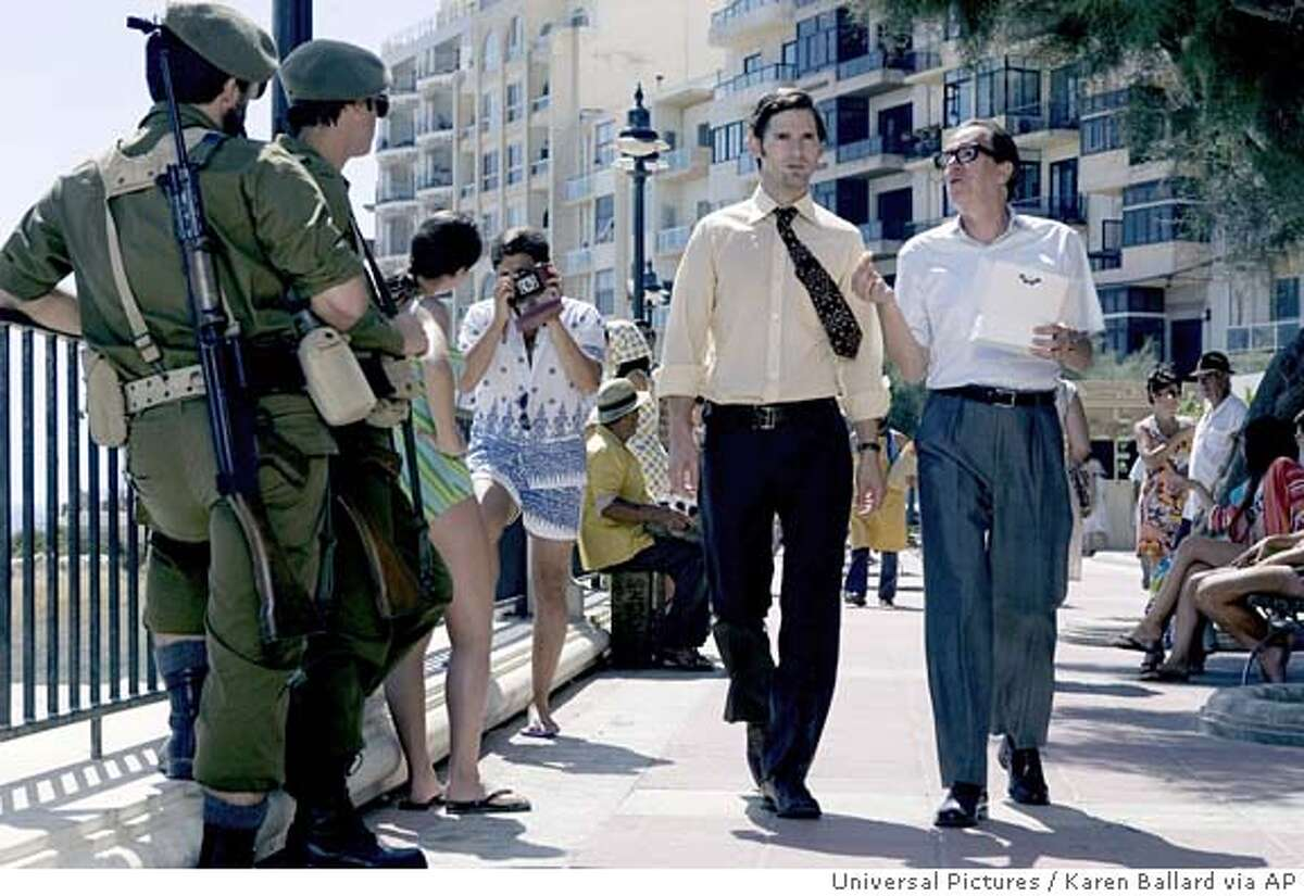 """In this photo provided by Universal Studios, after the massacre of 11 Israeli athletes at the 1972 Munich Olympics, Avner (Eric Bana) and Ephraim (Geoffrey Rush), are assigned to track down and kill the 11 Palestinians suspected to have planned the Munich attack in """"Munich."""" (AP Photo/Universal Pictures/Karen Ballard)"""