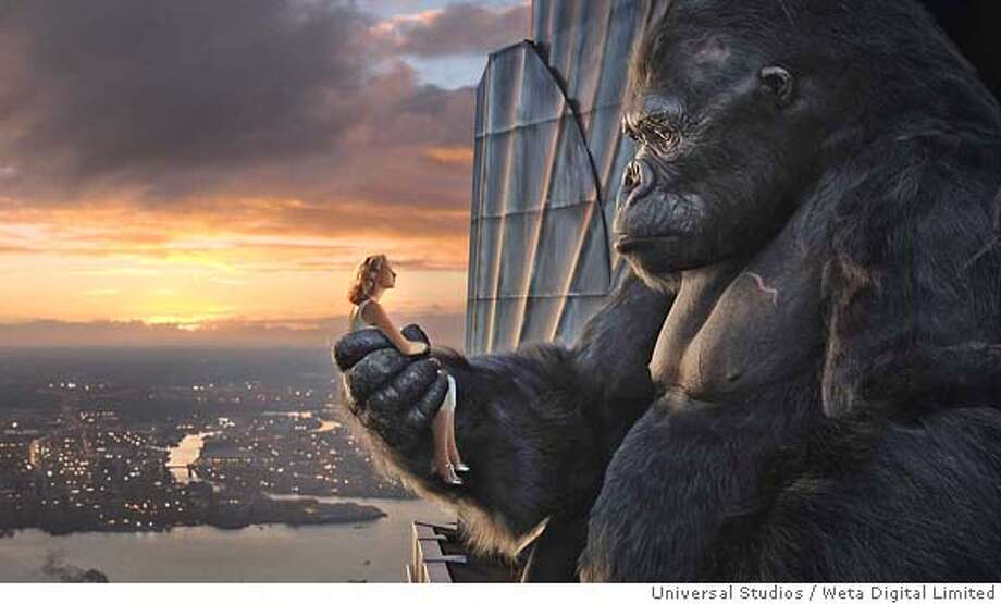 """In this photo provided by Universal Studios, Ann Darrow (Naomi Watts) shares a quiet moment at sunrise with Kong atop the Empire State Building, whose heights he has scaled in his flight from the streets of New York City, in """" ."""" (AP Photo/Universal Studios)"""