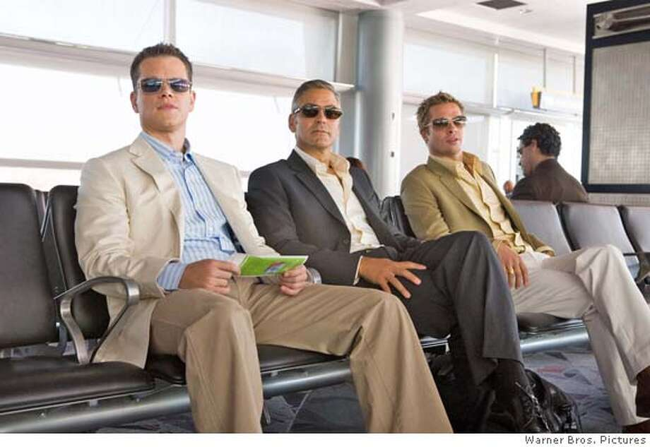 "(L-r) MATT DAMON stars as Linus Caldwell, GEORGE CLOONEY stars as Danny Ocean and BRAD PITT stars as Rusty Ryan in Warner Bros. Pictures' and Village Roadshow Pictures' ""Ocean's Thirteen,"" distributed by Warner Bros. Pictures. The film also stars Andy Garcia, Don Cheadle, Bernie Mac, Ellen Barkin and Al Pacino.  PHOTOGRAPHS TO BE USED SOLELY FOR ADVERTISING, PROMOTION, PUBLICITY OR REVIEWS OF THIS SPECIFIC MOTION PICTURE AND TO REMAIN THE PROPERTY OF THE STUDIO. NOT FOR SALE OR REDISTRIBUTION. Photo: -"