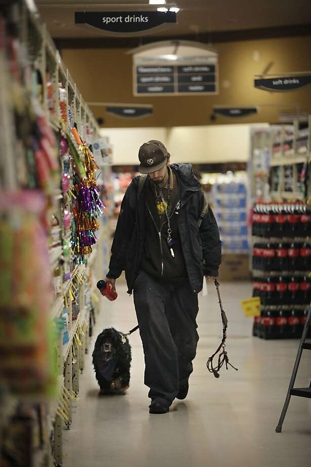 Nathan Dure of San Francisco walks through the aisle at the Safeway on Market at Church with his dog, Soldier Sargent Pepper, on Wednesday, February 15, 2012 in San Francisco, Calif.  Dure said his dog is a service dog. Photo: Lea Suzuki, The Chronicle