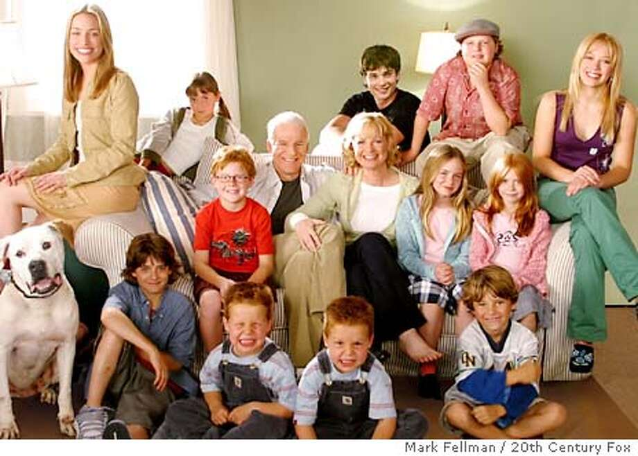 "Actress Bonnie Hunt and actor Steve Martin (C) are surrounded by the young cast in their new family comedy film ""Cheaper By The Dozen"" in a scene from the film in this undated publicity photograph. The film opens December 25, 2003 in the United States. REUTERS/Mark Fellman / 20th Century Fox/Handout REUTERS Photo: HO"