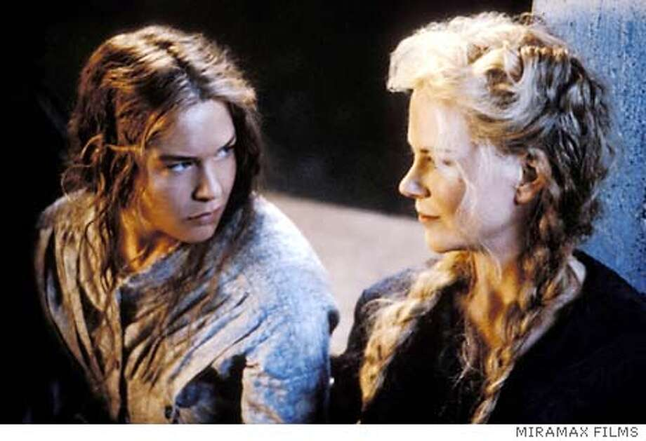 "Actresses Renee Zellweger (L) and Nicole Kidman are shown in a scene from their new film ""Cold Mountain"" directed by Anthony Minghella, in this undated publicity photograph. The film is set in the waning days of the American Civil War, and tells the story of a wounded soldier played by Jude Law who embarks on a perilous journey back home to Cold Mountain, North Carolina to reunite with his sweetheart played by Kidman. Zellweger plays a young drifter. The film opens December 25, 2003 in the United States. REUTERS/Miramax Films/Handout Photo: HO"