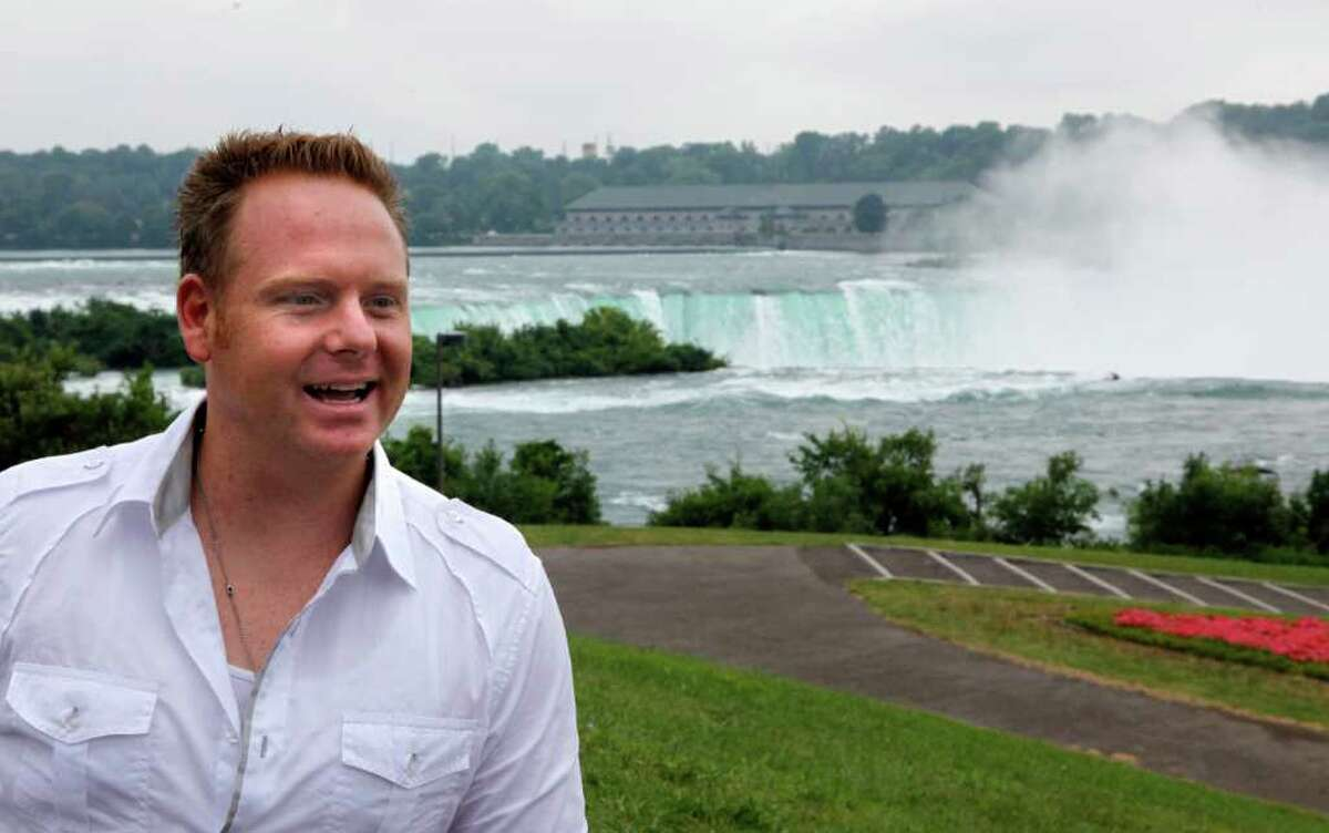 FILE - In this Aug. 3, 2011 file photo, tightrope walker Nik Wallenda poses for a photo after a news conference in Niagara Falls, N.Y. Wallenda has been given the go-ahead to walk a tightrope across Niagara Falls. The Canadian Parks Commission unanimously approved Wallenda's request during a meeting with him Wednesday, Feb. 15, 2012 in Niagara Falls, Ontairo. Wallenda wants to install a rope between the American and Canadian parkland at the Falls and walk from one country to the other. (AP Photo/David Duprey, File)