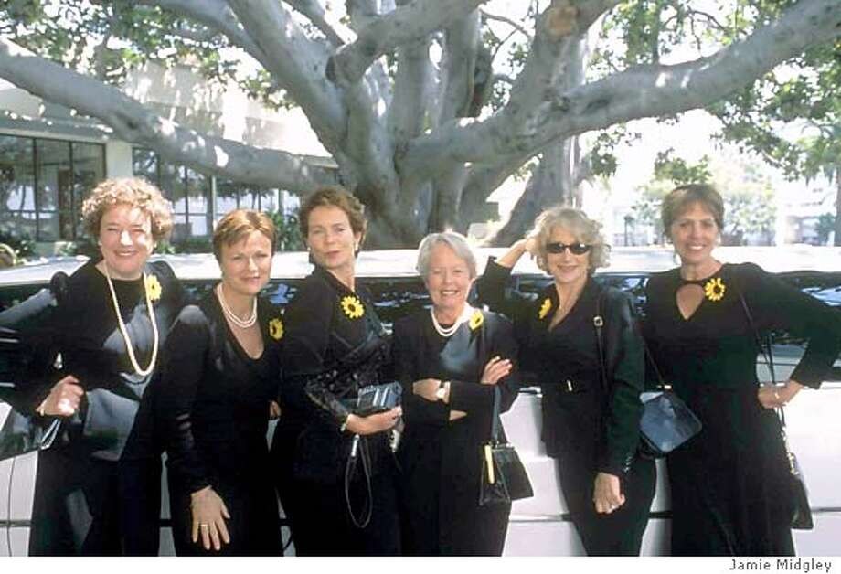 The members of the U.K.s Womens Institute - Cora (Linda Bassett, left), Annie Clark (Julie Walters, second from left), Celia (Celia Imrie, third from left), Jessie (Annette Crosby, third from right), Chris Harper (Helen Mirren, second from right), and Ruth (Penelope Wilton, right), raise eyebrows - among other things - when they pose nude in their annual fundraising calendar, in the Touchstone Pictures comedy, Calendar Girls. (AP Photo /Jamie Midgley) Photo: JAMIE MIDGLEY