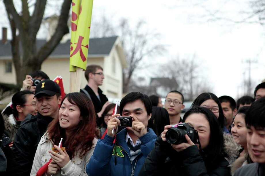 Chinese students from the University of Iowa wait to see Chinese Vice President Xi Jinping on his visit. Photo: STEVE HEBERT / NYTNS
