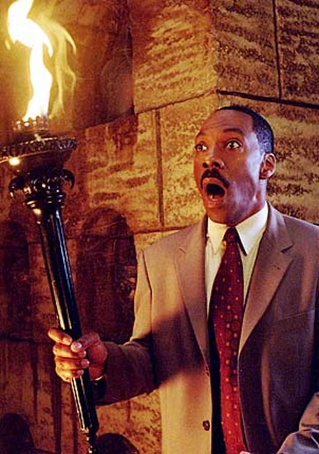 "** ADVANCE FOR THURSDAY NOV 27 **Actor Eddie Murphy appears in a scene from Walt Disney Pictures' comedy-adventure ""Haunted Mansion,"" in this undated promotional photo. After the successes of ""Daddy Day Care,"" the ""Dr. Dolittle"" movies and ""Shrek,"" kids and their parents are now the core of Murphy's fan-base, and family comedy has given his career its second wind. (AP Photo/Buena Vista Pictures Distribution, Bruce McBroom) Photo: BRUCE MCBROOM"
