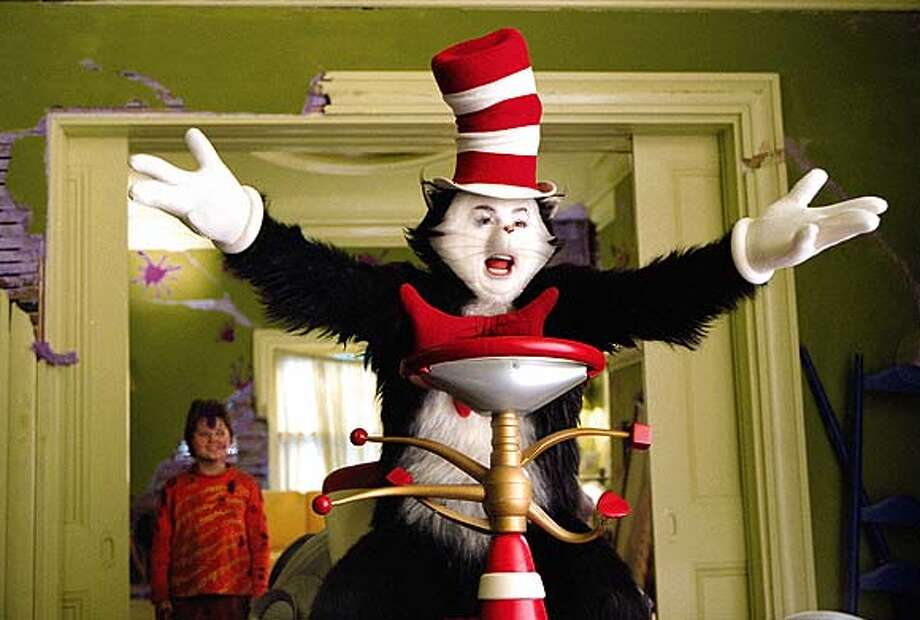 MIKE MYERS as the title character (with SPENCER BRESLIN as Conrad) in the live-action film adaptation of the beloved literary classic, Dr. Seuss' The Cat in the Hat. Film Title: Dr. Seuss' The Cat In The Hat.  Copyright: � 2003 Universal Studios and DreamWorks LLC. ALL RIGHTS RESERVED. Credit: Melinda Sue Gordon.