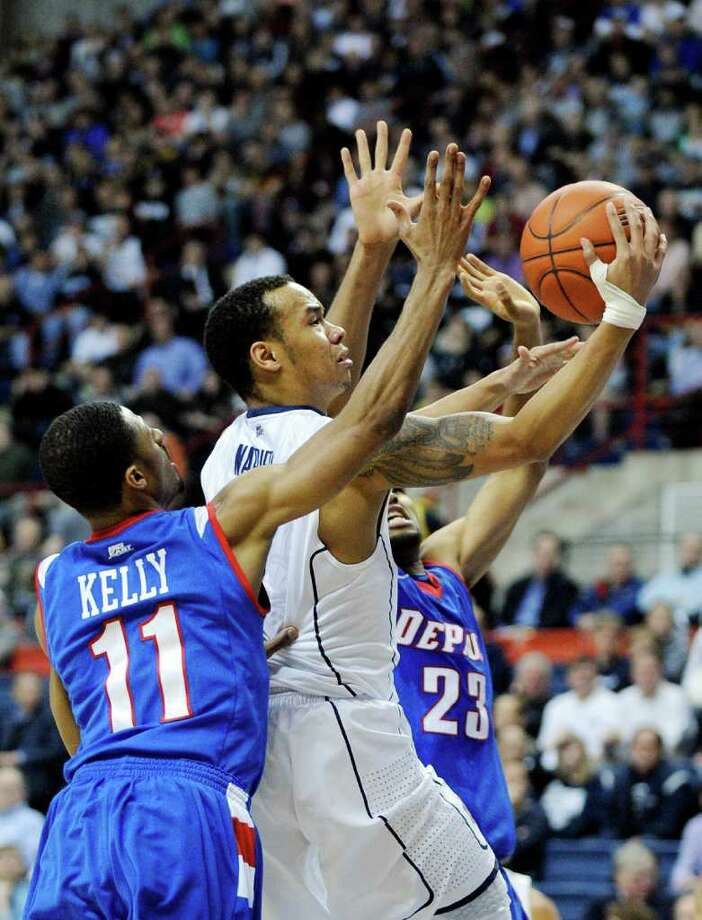 Connecticut's Shabazz Napier, center, drives past DePaul's Jeremiah Kelly (11) and Donnavan Kirk (23) during the first half of an NCAA college basketball game in Storrs, Conn., on Wednesday, Feb. 15, 2012. (AP Photo/Fred Beckham) Photo: Fred Beckham/Associated Press / FR153656 AP
