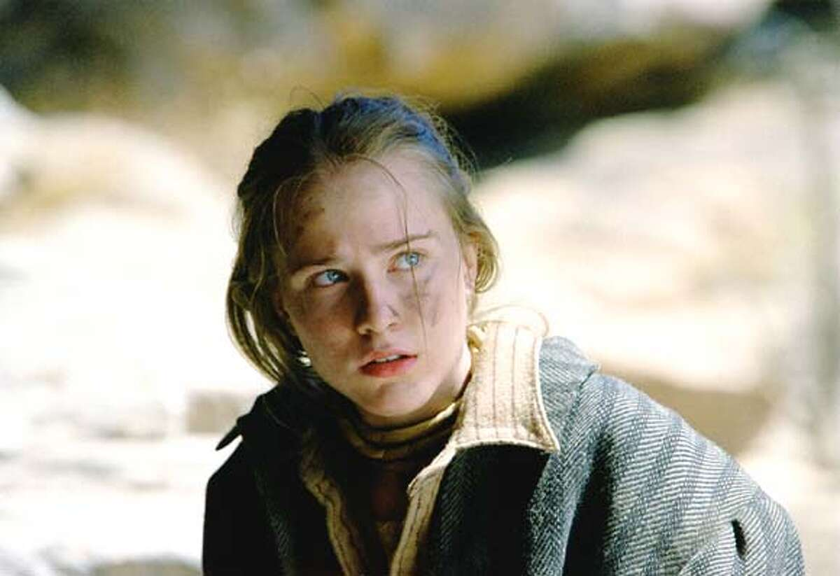 MISSING.jpg Evan Rachel Wood, plays Lilly, a young girl who is kidnapped by a vicious band of renegades in Revolution Studios� suspense thriller The Missing, a Columbia Pictures release. Photo by Eli Reed. �2003 Revolution Studios Distribution Company, LCC. All Rights reserved