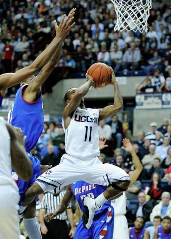 Connecticut's Ryan Boatright (11) drives to the basket against DePaul during the first half of an NCAA college basketball game in Storrs, Conn., on Wednesday, Feb. 15, 2012. (AP Photo/Fred Beckham) Photo: Fred Beckham/Associated Press / FR153656 AP