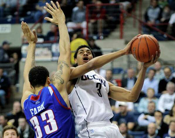 Connecticut's Jeremy Lamb, right, drives past DePaul's Krys Faber during the first half of an NCAA college basketball game in Hartford, Conn., on Wednesday, Feb. 15, 2012. (AP Photo/Fred Beckham) Photo: Fred Beckham/Associated Press / FR153656 AP