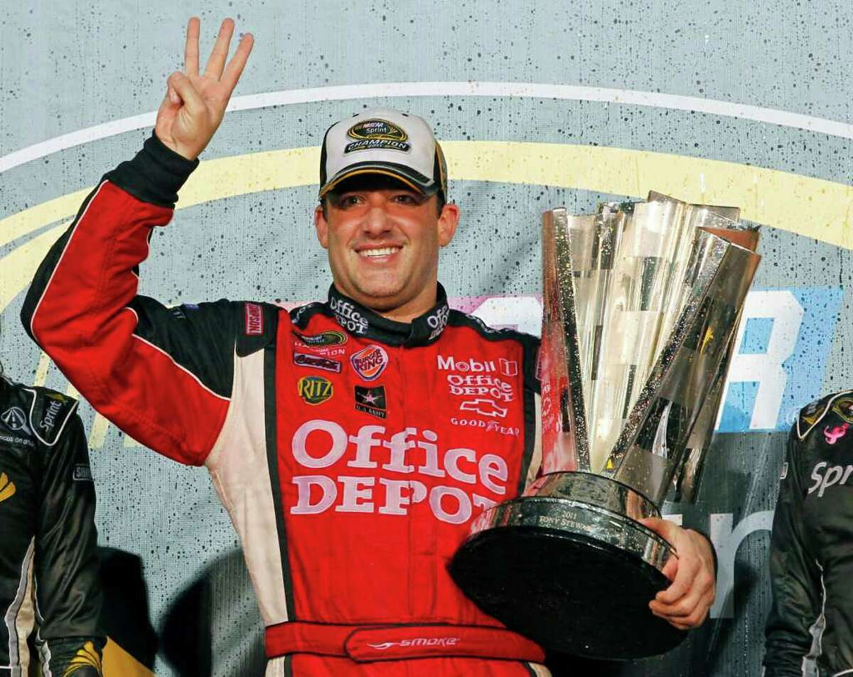 FILE - In this Nov. 20, 2011 file photo, Tony Stewart celebrates after winning his third NASCAR Sprint Cup Series championship, at Homestead-Miami Speedway in Homestead, Fla. Stewart stormed through the final 10 weeks of last season to steal the Sprint Cup title away from Carl Edwards. (AP Photo/Terry Renna, File)