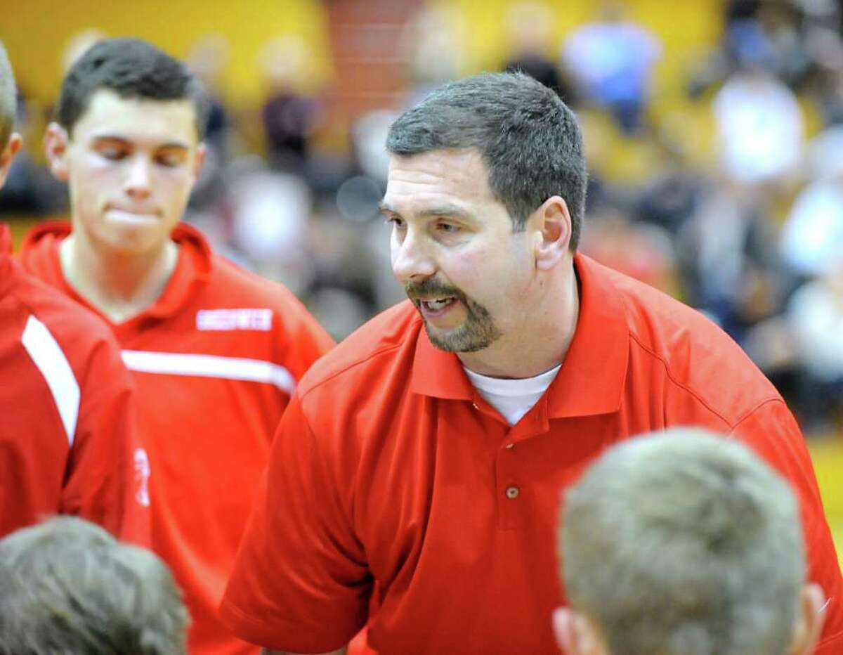 Greenwich coach Bill Brehm speaks with his team in the huddle during boys high school basketball game between Greenwich High School and St. Joe's of Trumbull at Greenwich, Wednesday, Feb. 15, 2012.