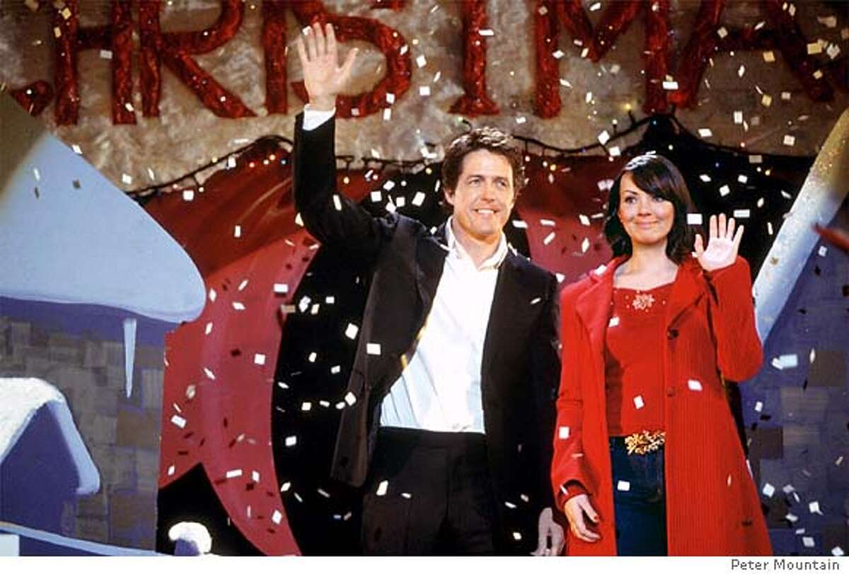 The Prime Minister (HUGH GRANT) and Natalie (MARTINE McCUTCHEON) are caught off-guard (and quite by accident) at a Christmas pageant in Richard Curtis� romantic comedy Love Actually. Photo Credit: Peter Mountain �2003 Universal Studios. All Rights Reserved.