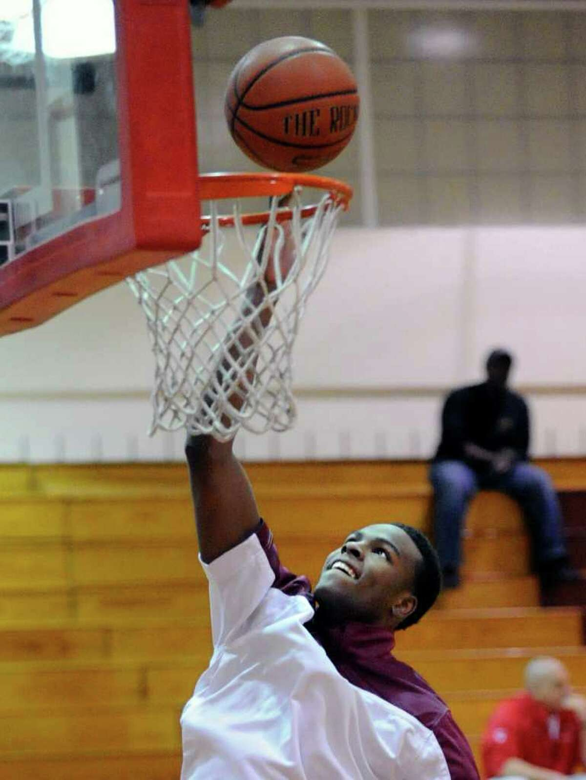 Timajh Parker of St. Joe's warms up at the start of the boys high school basketball game between Greenwich High School and St. Joe's of Trumbull at Greenwich, Wednesday, Feb. 15, 2012.