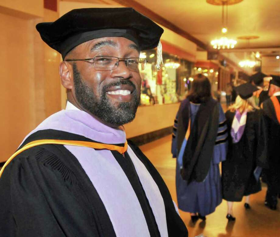 Schenectady County Community College's sixth president Quintin Bullock on his way to his inauguration ceremony at Proctor's Theatre in Schenectady Friday afternoon April 30, 2010.  (John Carl D'Annibale / Times Union archive) Photo: John Carl D'Annibale / 00008520A