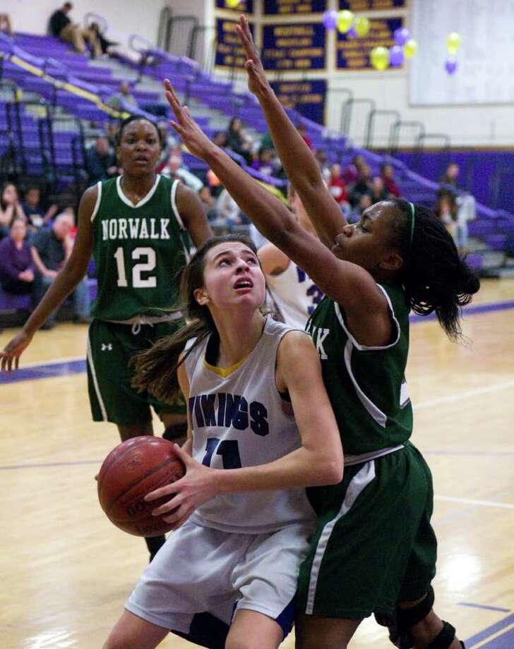 Westhill's Megan D'Alessandro looks to shoot as Norwalk's Zayna Fukton blocks as Westhill High School hosts Norwalk in a girls basketball game in Stamford, Conn., February 15, 2012. Photo: Keelin Daly / Stamford Advocate