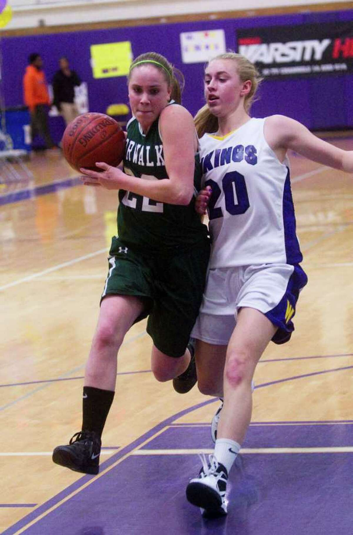 Norwalk's Katie Schmidt and Westhill's Stephanie Roones battlle as Westhill High School hosts Norwalk in a girls basketball game in Stamford, Conn., February 15, 2012.