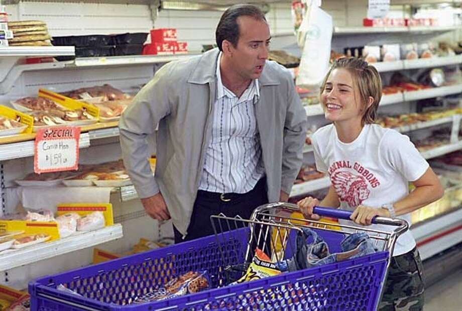 "For FILMCLIPS12, Datebook ; (L-r) NICOLAS CAGE and ALISON LOHMAN star in Warner Bros. Pictures' comedy ""Matchstick Men"" ; Photo: Francois Duhamel ; on 8/11/03 in . / Warner Brothers Pictures Photo: Francois Duhamel"