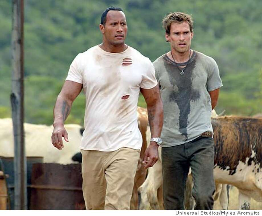 "**RETRANSMISSION TO FIX SPELLING OF SCOTT'S FIRST NAME**Actors The Rock, left, and Seann William Scott are shown in a scene from Universal Studios action adventure ""The Rundown,"" in this undated promotional photo. The Rock stars as Beck, a bounty hunter armed only with his wits and fists, who battles various foes, including freakish monkeys, while hunting for a wisecracking amateur archaeologist played by Scott whose father is a ruthless loan shark. (AP Photo/Myles Aromwitz, Universal Studios) Photo: MYLES AROMWITZ"