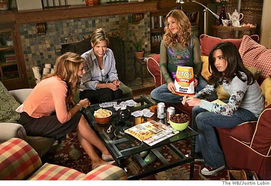 """GOODMAN05 Related  """"Moving Out, Moving In, Moving On"""" (Episode #101)  Image #RE101-0023A  Pictured (l-r): Jennifer Esposito as Ginnie Sorreli, Kiele Sanchez as Ann Sorreli, Lizzy Caplan as Marjee Sorelli, Lauren Breckenridge as Rose Sorelli  Photo Credit: ��The WB/Justin Lubin Photo: The WB"""