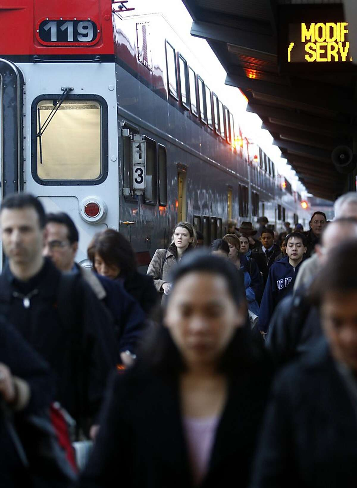 Commuters arrive on a Baby Bullet train at the Caltrain station in San Francisco, Calif., on Wednesday, Dec. 22, 2010. Caltrain will start operating the Baby Bullet express service on weekends beginning Jan. 1 for a trial period.