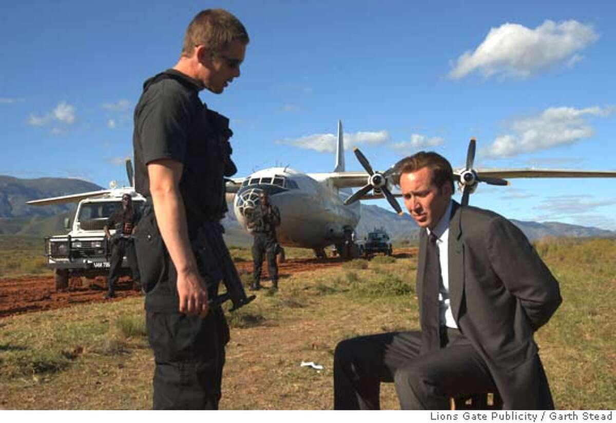 LORD16_04.JPG Valentine (Ethan Hawke) and Yuri Orlov (Nicolas Cage) in LORD OF WAR. Photo credit: Garth Stead / Lions Gate Publicity