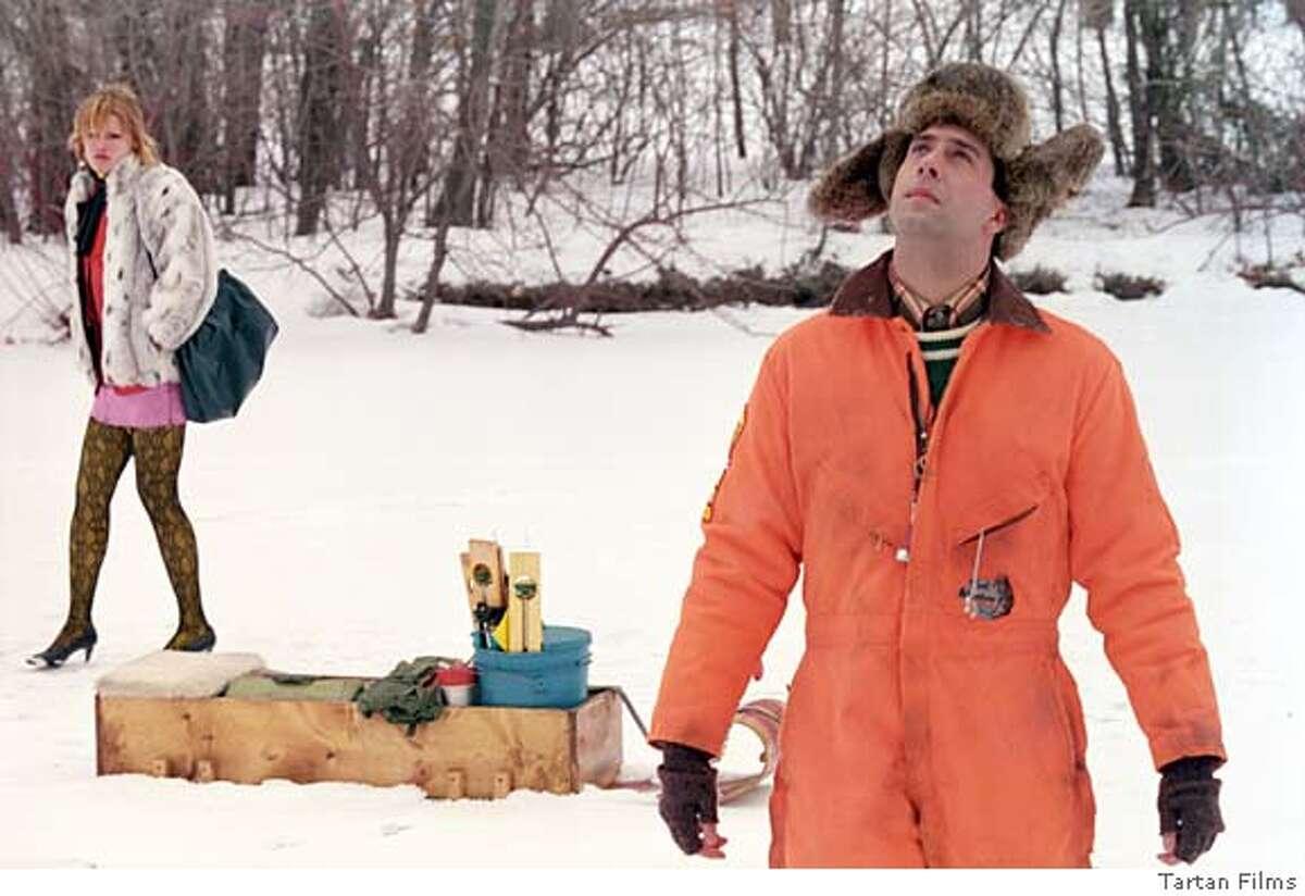 MILWAUKEE09 Alison Folland (left), Troy Garity (right) in Milwaukee, Minnesota. c. Tartan Films 2005