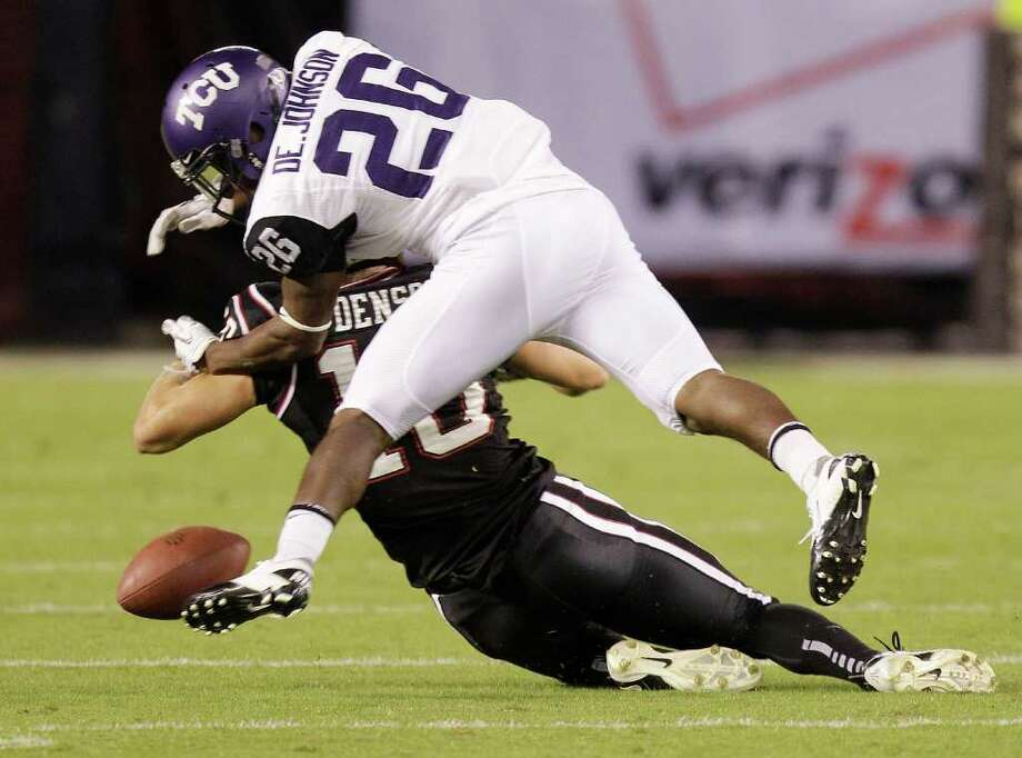 In this Oct. 8, 2011 file photo, Texas Christian University cornerback Devin Johnson (26) strips the ball away from San Diego State receiver Dylan Denso during the first half of a NCAA football game, in San Diego. Photo: AP