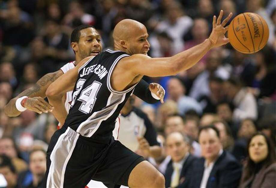 Toronto Raptors forward James Johnson, left, battles for the ball against San Antonio Spurs forward Richard Jefferson during first-half NBA basketball game action in Toronto on Wednesday, Feb. 15, 2012. (AP Photo/The Canadian Press, Nathan Denette) Photo: Nathan Denette, AP / The Canadian Press