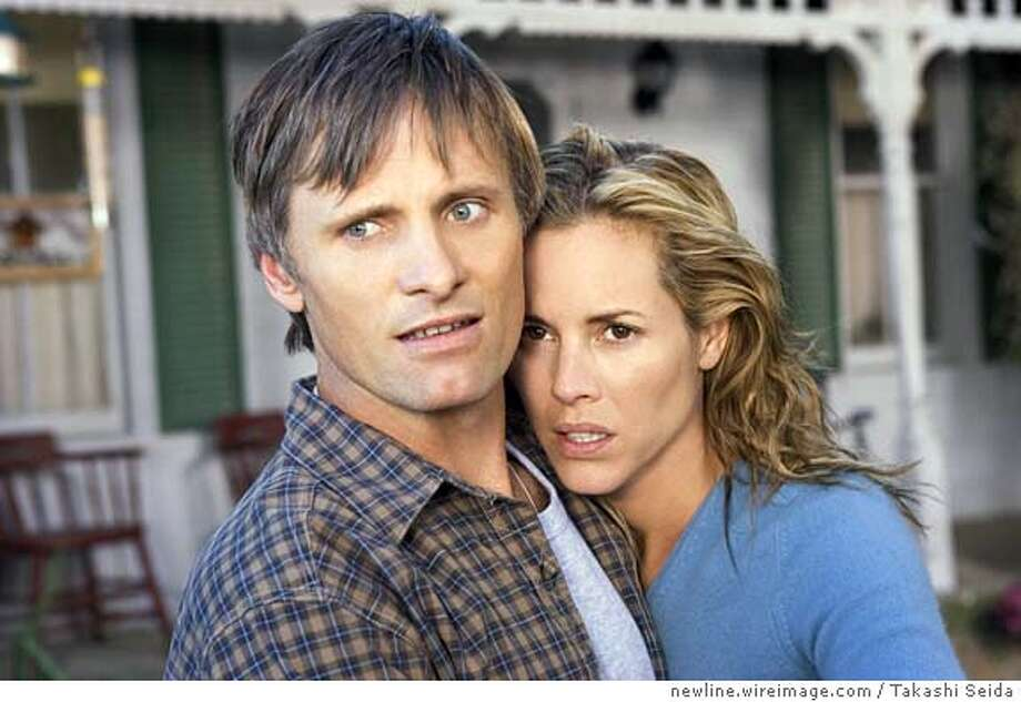 "HISTORY23 ""Tom Stall""(Viggo Mortensen) and his wife ""Edie Stall""(Maria Bello) have unexpected visitors in New Line Cinema�s thriller A History of Violence. March 1, 2005  Photo by Takashi Seida/newline.wireimage.com Photo: Takashi Seida"