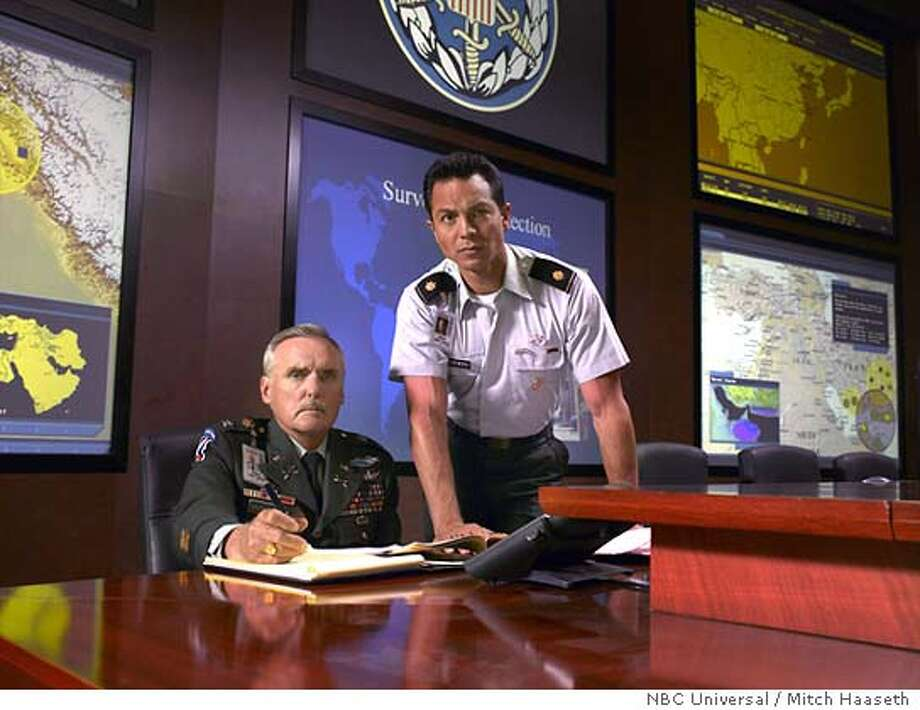 E-RING -- NBC Series -- Pictured: (l-r) Dennis Hopper as Colonel McNulty, Benjamin Bratt as Jim Tisnewski -- NBC Universal Photo: Mitch Haaseth NBC Media Photo: Mitch Haaseth