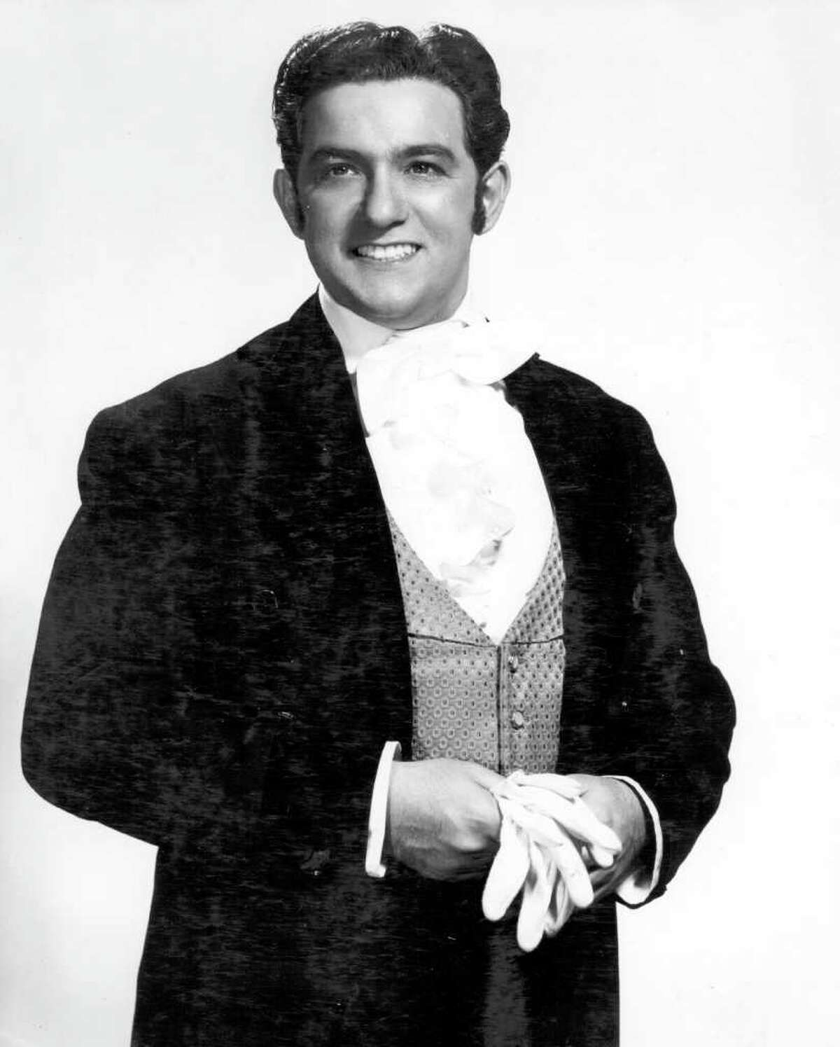"""In this 1957 photo released by The Metropolitan Opera, tenor Charles Anthony is shown in a promotional photo for Verdi's """"La Traviata."""" Anthony, who holds the record for most appearances at the Metropolitan Opera during a career that spanned from 1954-2010, died Wednesday, Feb. 15, 2012 in Florida. He was 82. (AP Photo/The Metropolitan Opera)"""