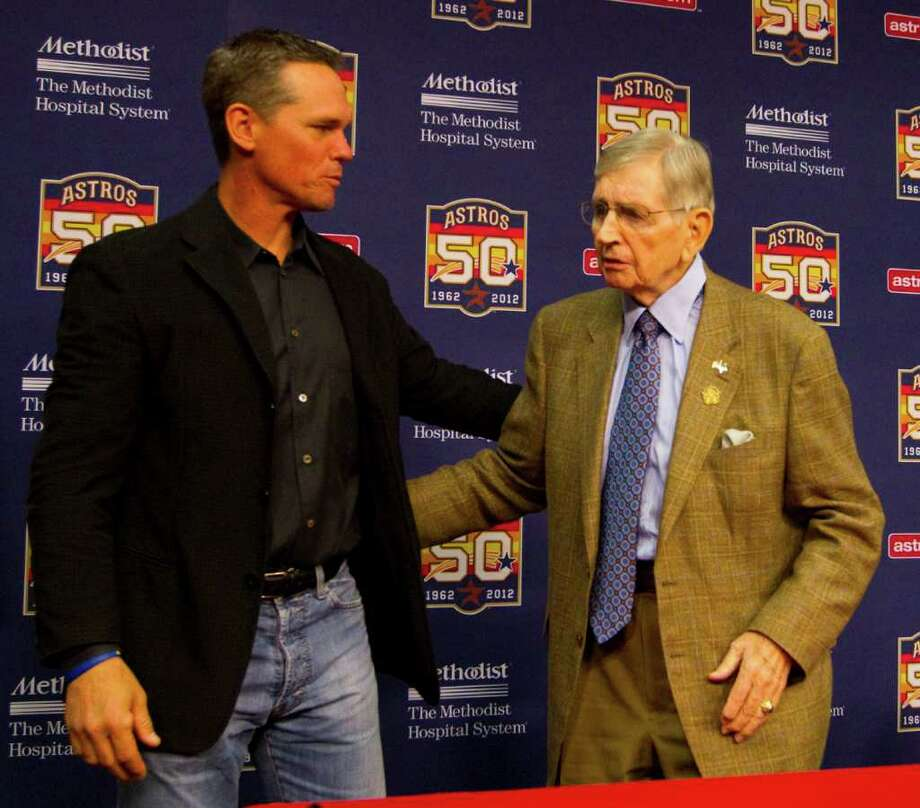 Craig Biggio, left, joins another longtime Astros staple - Milo Hamilton - for the announcement that 2012 will be Hamilton's last season calling games. Photo: Karen Warren / © 2012  Houston Chronicle