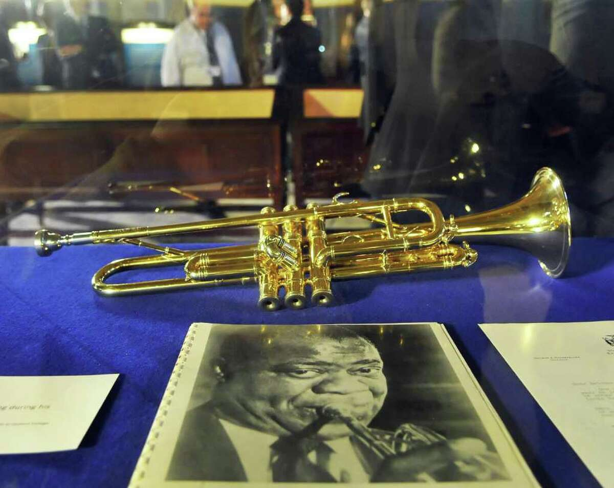 One of Louis Armstrong's trumpets on display at a Capitol exhibit honoring prominent African-American New Yorkers in recognition of Black History at the Capitol Wednesday Feb. 15, 2012. (John Carl D'Annibale / Times Union)