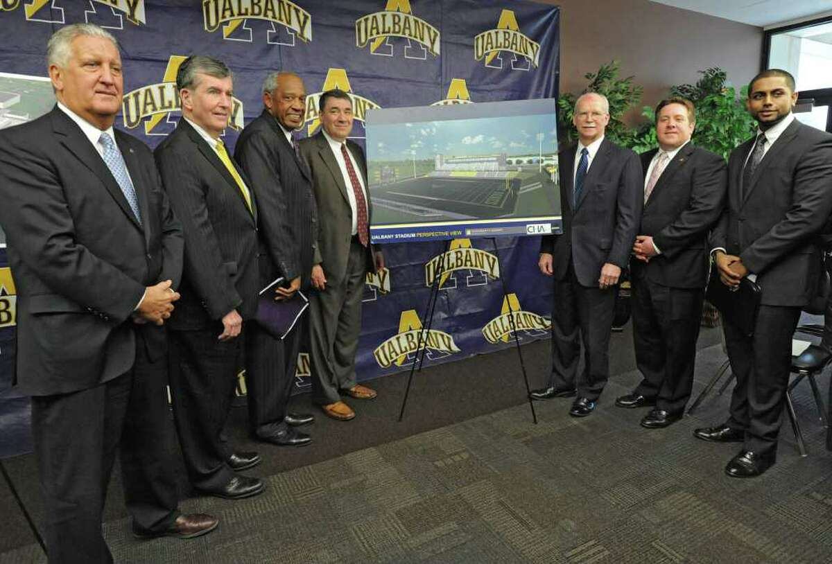 From left, Albany Mayor Jerry Jennings, Senator Neil Breslin, UAlbany Vice President and Director of Athletics Lee McElroy, University at Albany President George Philip, president of the University at Albany Foundation George Hearst, Albany County Executive Daniel P. McCoy and president of the UAlbany Student Association Zafir Uddin stand next to a rendering of the New Athletic Field Complex at UAlbany on Wednesday, Feb. 15, 2012 in Albany, N.Y. (Lori Van Buren / Times Union)