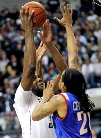 Connecticut's Alex Oriakhi shoots over DePaul's Jamee Crockett during the first half of an NCAA college basketball game in Storrs, Conn., on Wednesday, Feb. 15, 2012. Connecticut won 80-54. (AP Photo/Fred Beckham) Photo: Fred Beckham, Associated Press / FR153656 AP