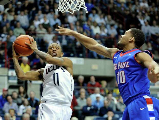 Connecticut's Ryan Boatright (11) drives past DePaul's Derrell Robertson during the second half of  an NCAA college basketball game in Storrs, Conn., on Wednesday, Feb. 15, 2012. Connecticut won 80-54. (AP Photo/Fred Beckham) Photo: Fred Beckham, Associated Press / FR153656 AP