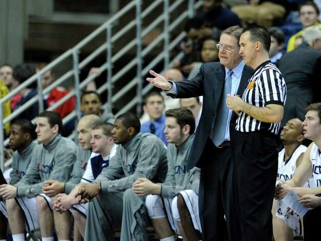 Connecticut associate head coach George Blaney speaks with an official during the first half of an NCAA college basketball game against DePaul in Storrs, Conn., on Wednesday, Feb. 15, 2012. (AP Photo/Fred Beckham) Photo: Fred Beckham, Associated Press / FR153656 AP