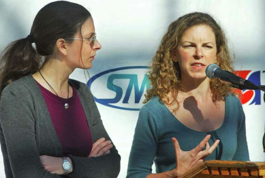 Clare Bronfman, left, and sister Sara Bronfman discuss the schedule of events for the Dalai Lama's upcoming visit to Albany at a news conference Tuesday morning March 17, 2009, at the Times Union Center. (John Carl D'Annibale / Times Union)