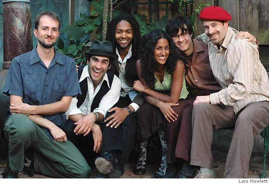 The Fishes: from left to right are eric perney (upright bass), aaron kierbel (percussion), marcus cohen (trumpet), rupa marya (songwriter, vocals, guitar), ed baskerville (cello), adrian jost (accordion). Credit: Lars Howlett Photo: Lars Howlett