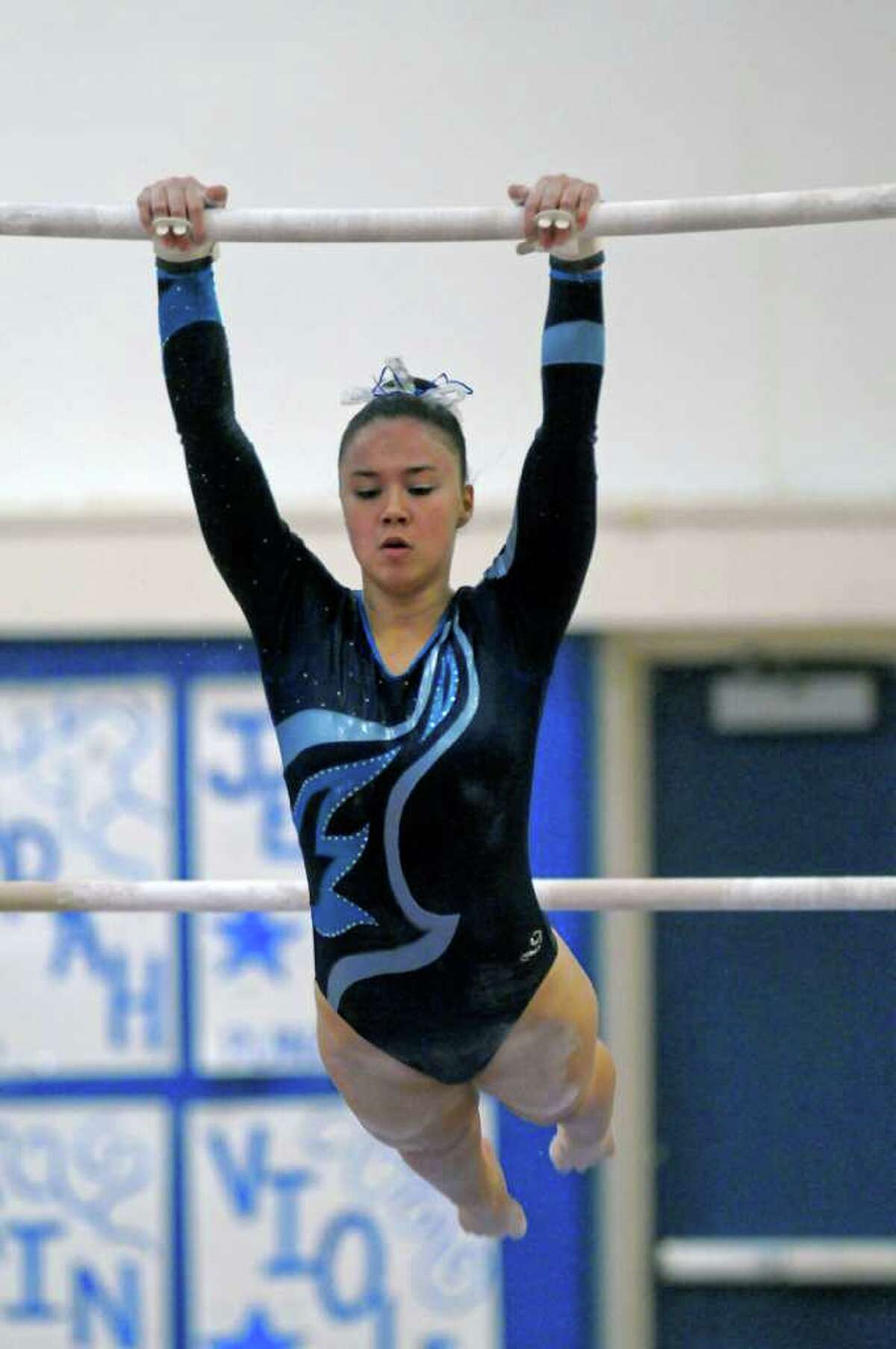 Saratoga's Rema Bianco competes on the bars during the Section II gymnastics championship at Shaker High School on Wednesday Feb. 15, 2012 in Latham, NY. She won the overall individual title. (Philip Kamrass / Times Union )