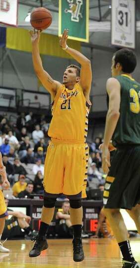 UAlbany's Blake Metcalf shoots a jump shot during a basketball game against Vermont at SEFCU arena o