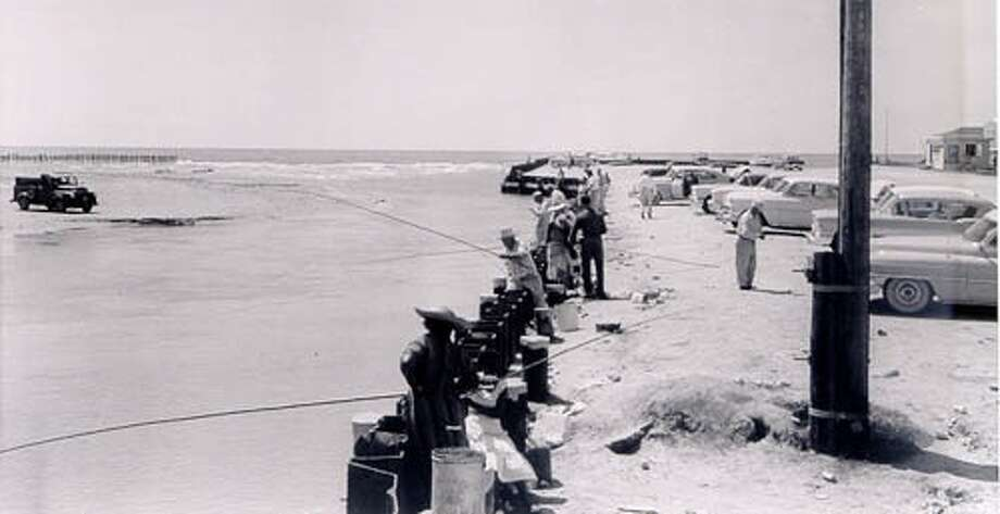 Since its creation four years before this 1958 photo was taken, Bolivar Peninsula's Rollover Pass has been as controversial for its environmental and economic impacts as it has been wildly popular as a public fishing spot. Photo: File / Beaumont