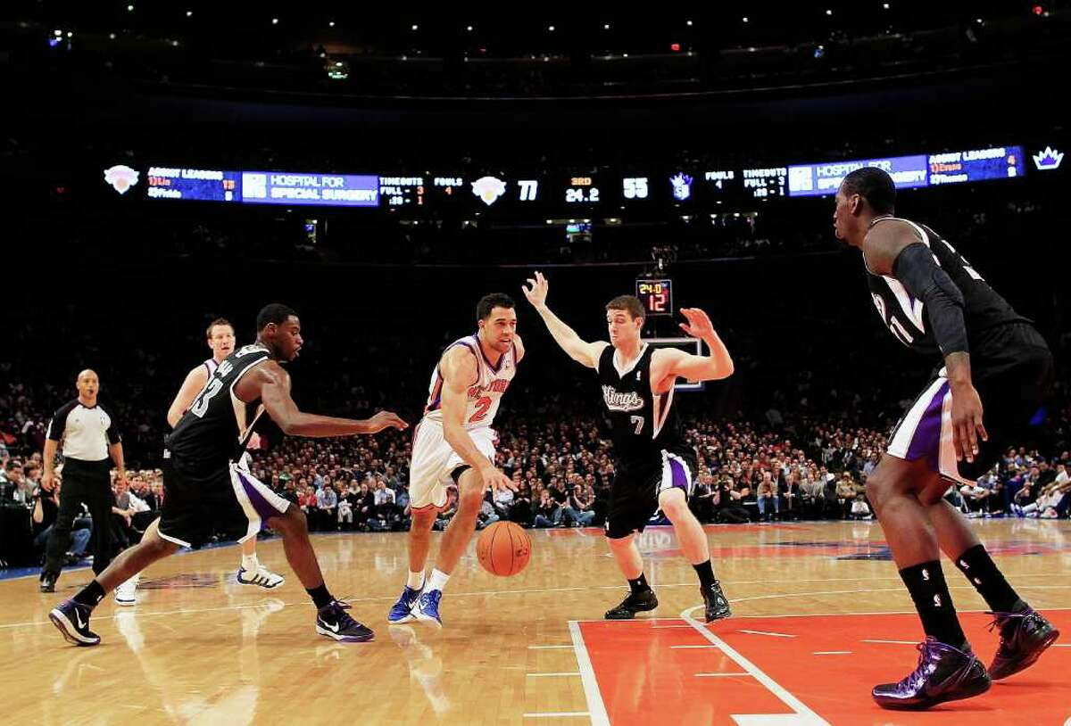 NEW YORK, NY - FEBRUARY 15: Landry Fields #2 of the New York Knicks drives past Jimmer Fredette #7 of the Sacramento Kings at Madison Square Garden on February 15, 2012 in New York City. NOTE TO USER: User expressly acknowledges and agrees that, by downloading and/or using this Photograph, user is consenting to the terms and conditions of the Getty Images License Agreement. (Photo by Chris Trotman/Getty Images)