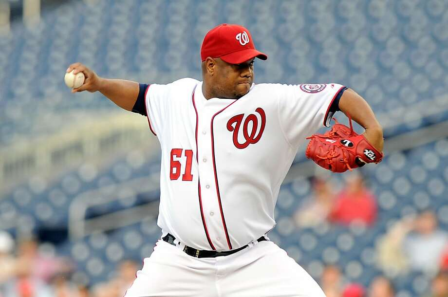 WASHINGTON, DC - JUNE 15:  Livan Hernandez #61 of the Washington Nationals pitches against the St. Louis Cardinals at Nationals Park on June 15, 2011 in Washington, DC. Photo: Greg Fiume, Getty Images