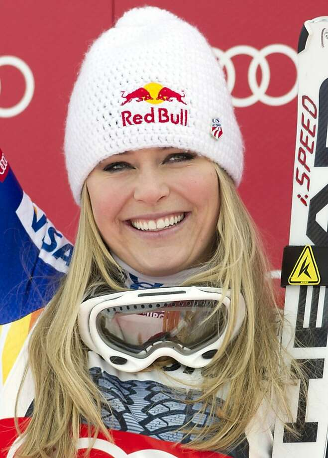 US Lindsey Vonn smiles on the podium after winning the women's Alpine skiing downhill World Cup in Garmisch-Partenkirchen, southern Germany, on February 4, 2012. Vonn reached her 50th World Cup career victory in the Kandahar downhill race. Kamer finished second and Weirather third. AFP PHOTO / JOHANNES EISELE (Photo credit should read JOHANNES EISELE/AFP/Getty Images) Photo: Johannes Eisele, AFP/Getty Images