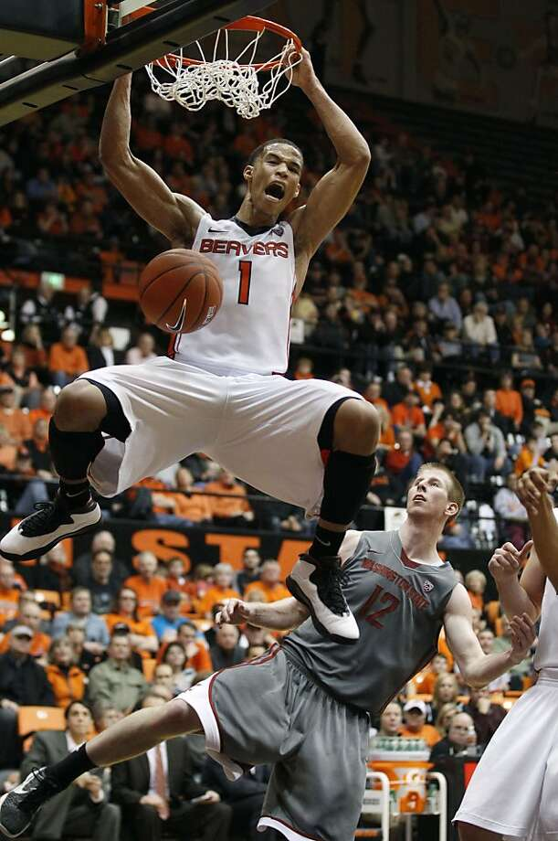 Oregon State guard Jared Cunningham (1) dunks the ball as Washington State forward Brock Motum (12) looks on in the second half during an NCAA college basketball game Thursday, Feb. 9, 2012, in Corvallis, Ore. (AP Photo/Rick Bowmer) Photo: Rick Bowmer, Associated Press